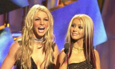 Britney Spears laughs as Christina Aguilera looks on at the MTV VMAs
