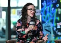 Jessica Stern wears a floral shirt as she speaks into a microphone