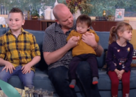 Ben Carpenter with three of his six adopted children