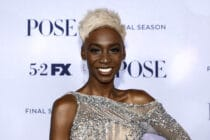 Angelica Ross with short blonde hair, smiling