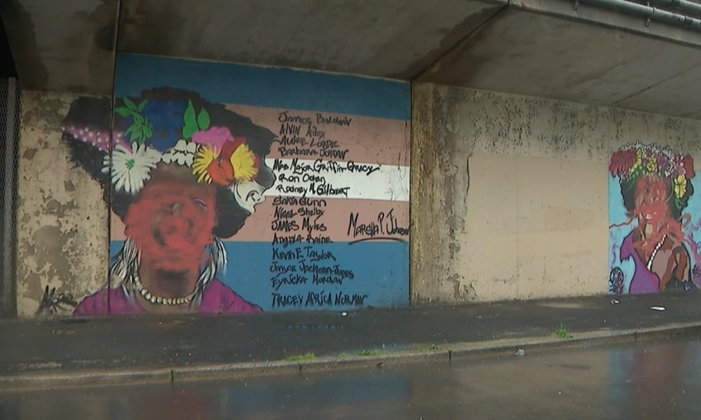 A mural of Marsha P Johnson in a street underpass