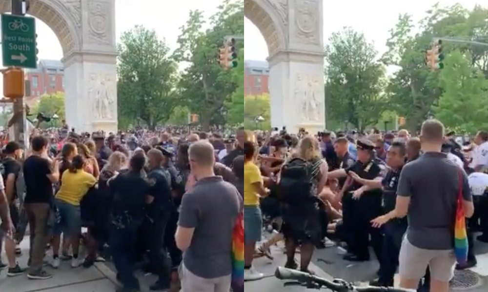 With the arch visible, police pack the streets outside Washington Square Park