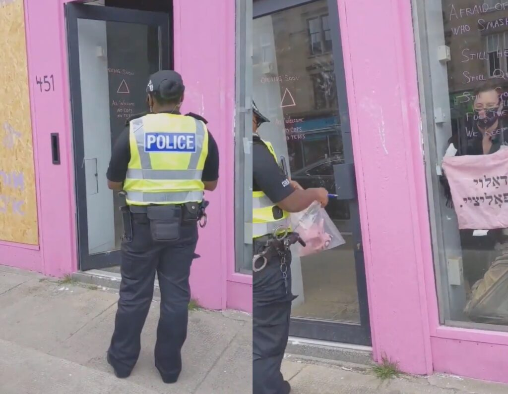 """Police seizing a """"f**k the police"""" tote bag as evidence from the queer, anarchist Jewish cafe Pink Peacock"""