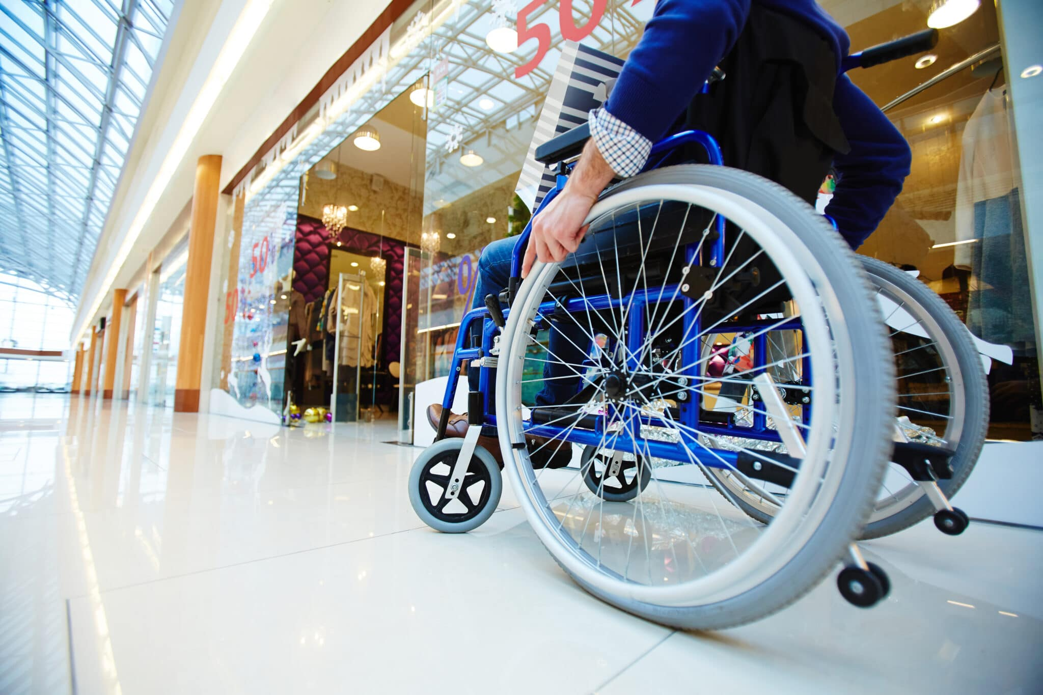 Woman pushed man out of wheelchair and kicked cop in racist, homophobic rampage