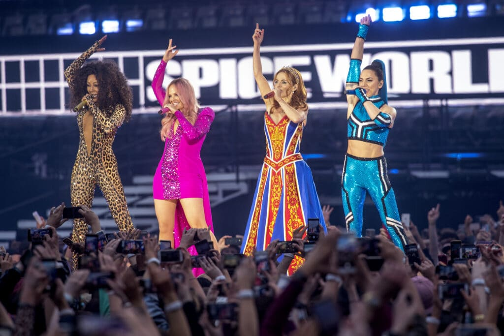 The Spice Girls performing on stage in 2019