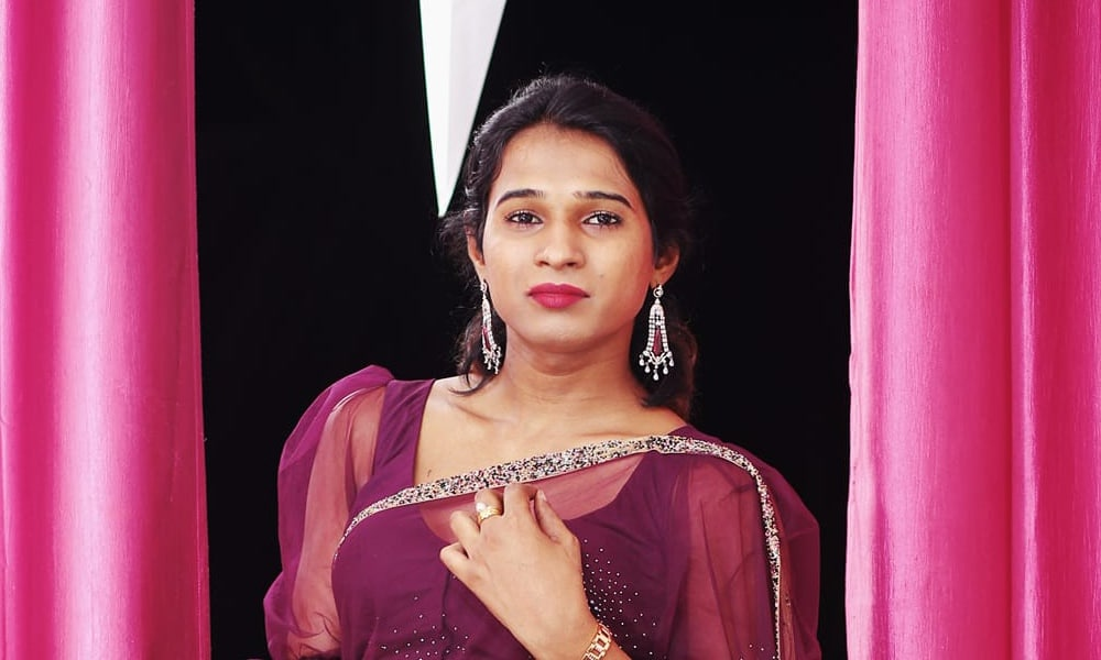 Anannyah Kumari Alex against pink curtains and in a purple dress