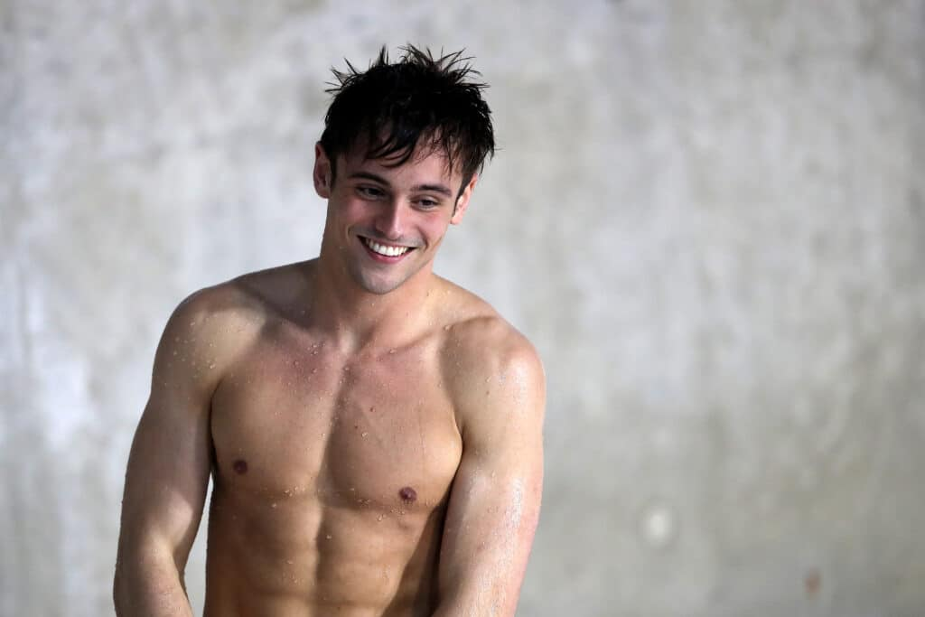 Tom Daley steps out of the pool shirtless