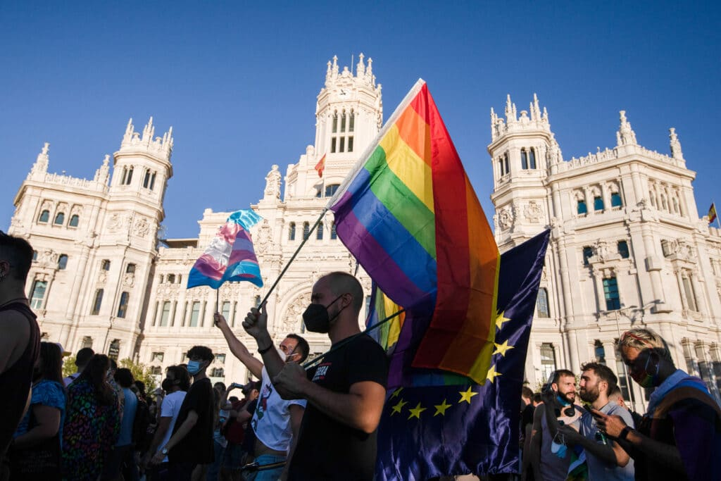 A protester waves a Pride flag in Madrid, Spain