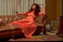 Musician Kate Bush posed on a sofa covered with party streamers in promotion of her one-off Christmas television special, Kate, circa 1979.