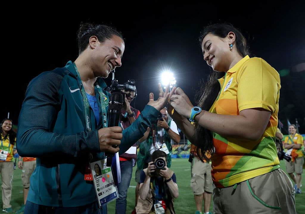 Marjorie Enya (R) proposes marriage to rugby player Isadora Cerullo