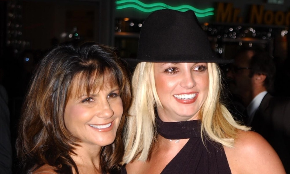 Lynne Spears (L) and Britney Spears pose for the camera wearing black