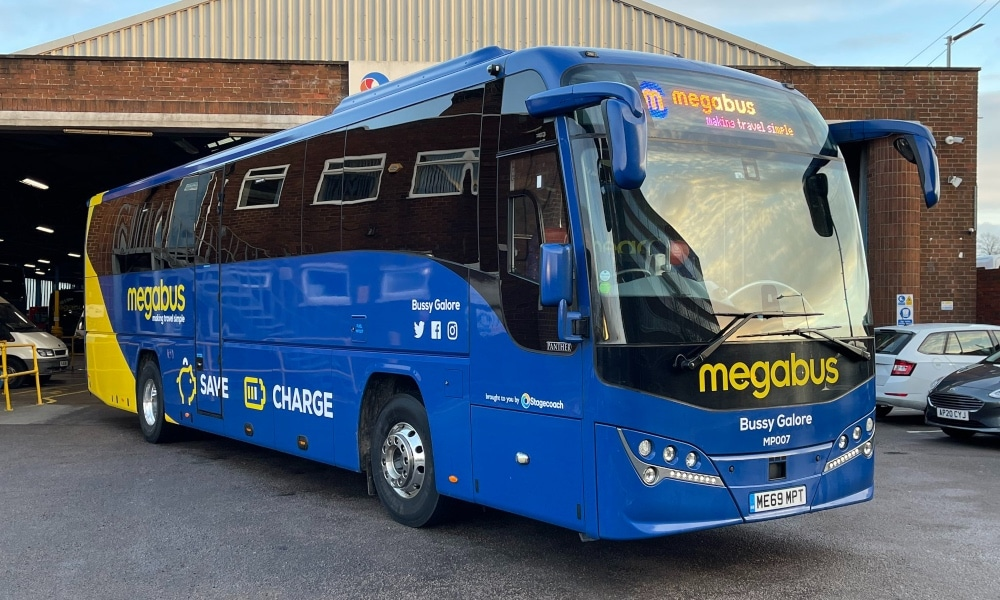A blue bus with the words 'Bussy Galore' on the front