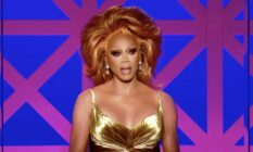 RuPaul dressed in a gold dress appears as judge on Drag Race