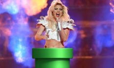 Lady Gaga sings as she rises out of a warp pipe