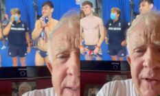 Half of Leslie Jordan's face in front of a television screen of Tom Daley and Matty Lee at the Olympics