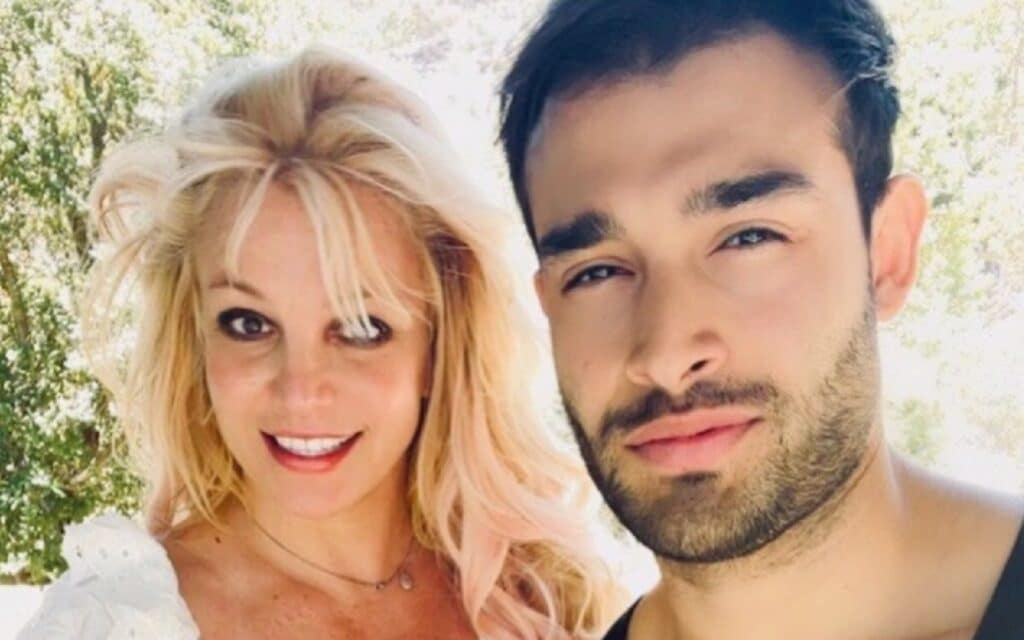 Britney Spears poses with her boyfriend Sam Asghari at their California home
