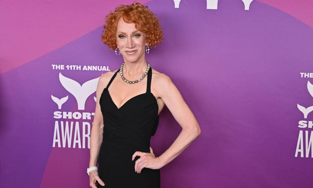 Kathy Griffin in black outfit amid purple background at the 11th Annual Shorty Awards in 2019