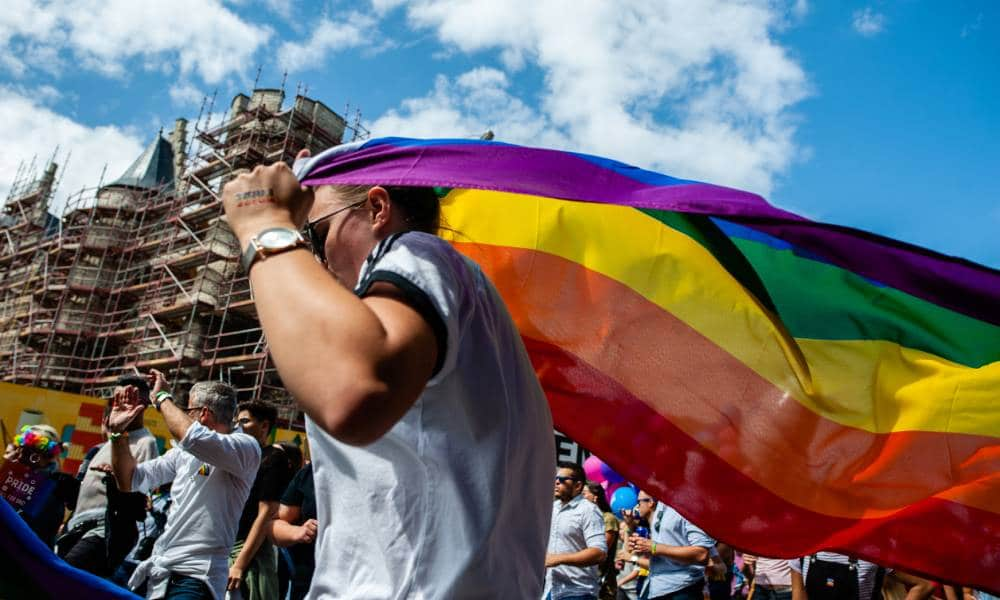 A person holds an LGBT+ Pride flag during the Antwerp Pride event in 2019 the pride march is used to stand up to homophobia and transphobia as well as celebrate the LGBT+ community in Belgium
