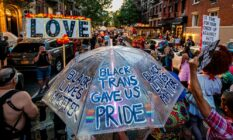 A participant seen holding an umbrella turned into a LGBT+ rights and BLM sign