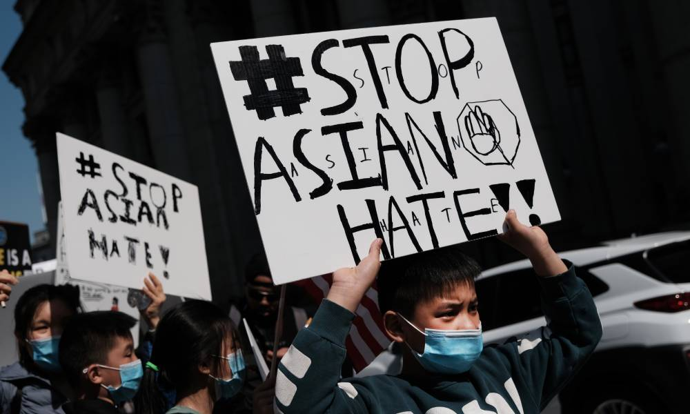 People participate in a protest to demand an end to anti-Asian violence in the US