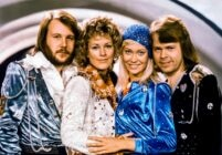 The four original members of ABBA posing for a photo together after winning the Eurovision Song Contest