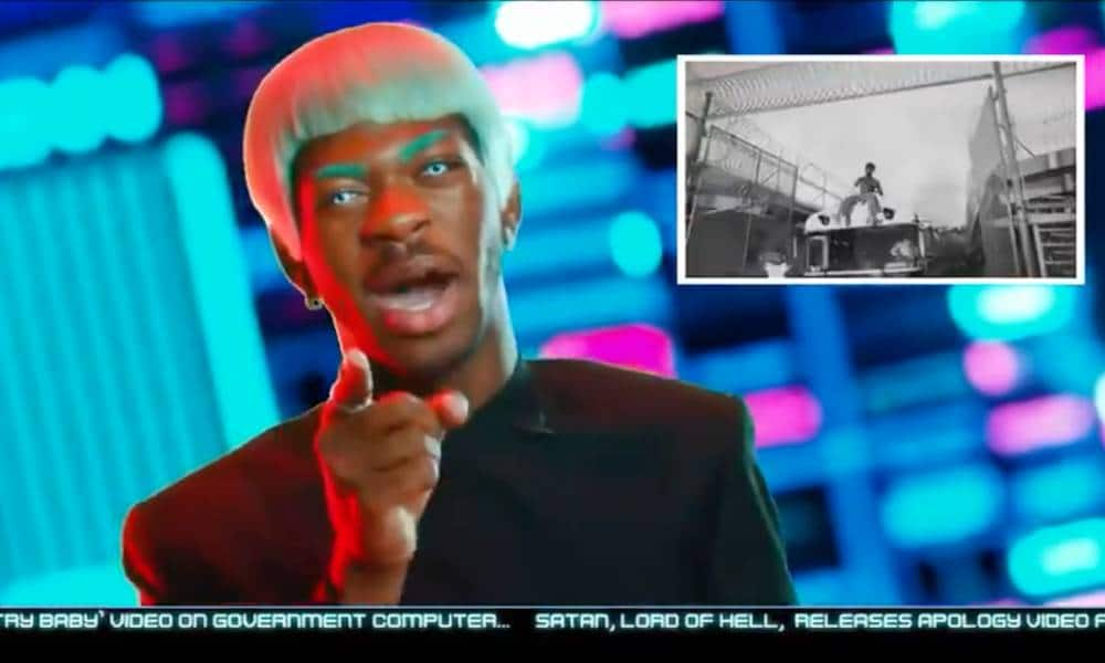 Lil Nas X dressed as a reporter breaking the news that his rapper persona escaped prison in trailer for upcoming debut Montero album