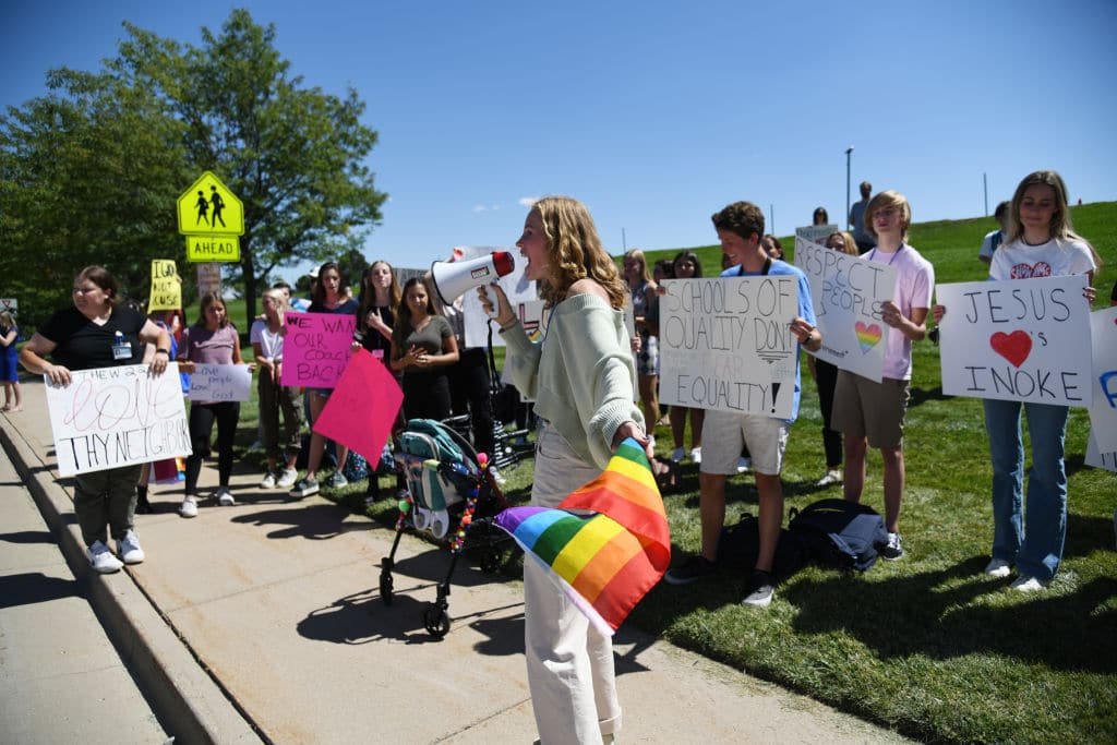 Ivie Hunt, 15, front, and about 50 Valor Christian High School students walked out of classes to support a volleyball coach Inoke Tonga, who says he was forced to leave his job over his sexuality, in front of the high school in Highlands Ranch, Colorado on Tuesday, August 24, 2021.