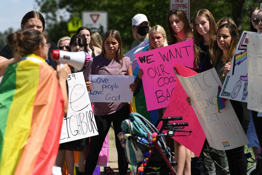 Avery Calvert, 16, left, and about 50 Valor Christian High School students walked out of classes to support a volleyball coach Inoke Tonga, who says he was forced to leave his job over his sexuality, in front of the high school in Highlands Ranch, Colorado on Tuesday, August 24, 2021.