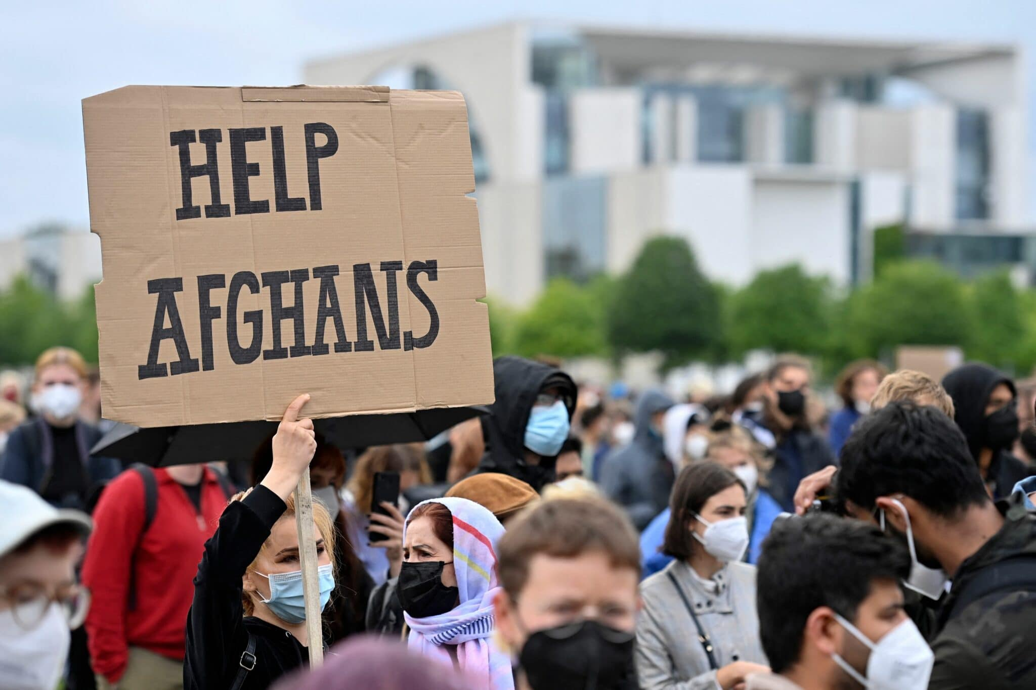 A participant holds up a placard reading 'Help Afghans' during a demonstration