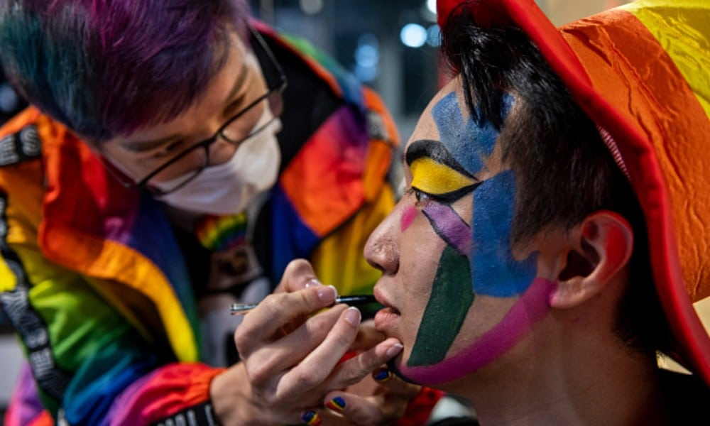 Pro-democracy activist Jimmy Sham Tsz-Kit getting his face painted in rainbow colours during 2020 Hong Kong Pride