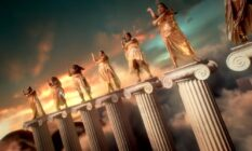 Lizzo and dancers standing atop Greek columns