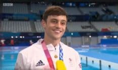 Tom Daley with his Olympic medal round his neck