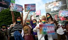 Demonstrators hold up signs in support of LGBT+ legislation in the Shibuya district of Tokyo, Japan