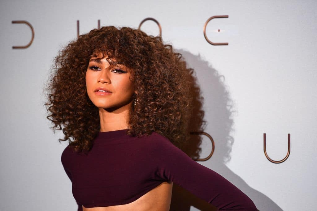 """US actress Zendaya Coleman, aka Zendaya poses during a photocall ahead of the avant-premiere of the science-fiction movie """"Dune"""" at the Grand Rex cinema hall in Paris on September 6, 2021."""