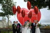 Couples pose during a photo event during a nationwide referendum's day on same-sex marriage, in Swiss capital Bern on September 26, 2021.