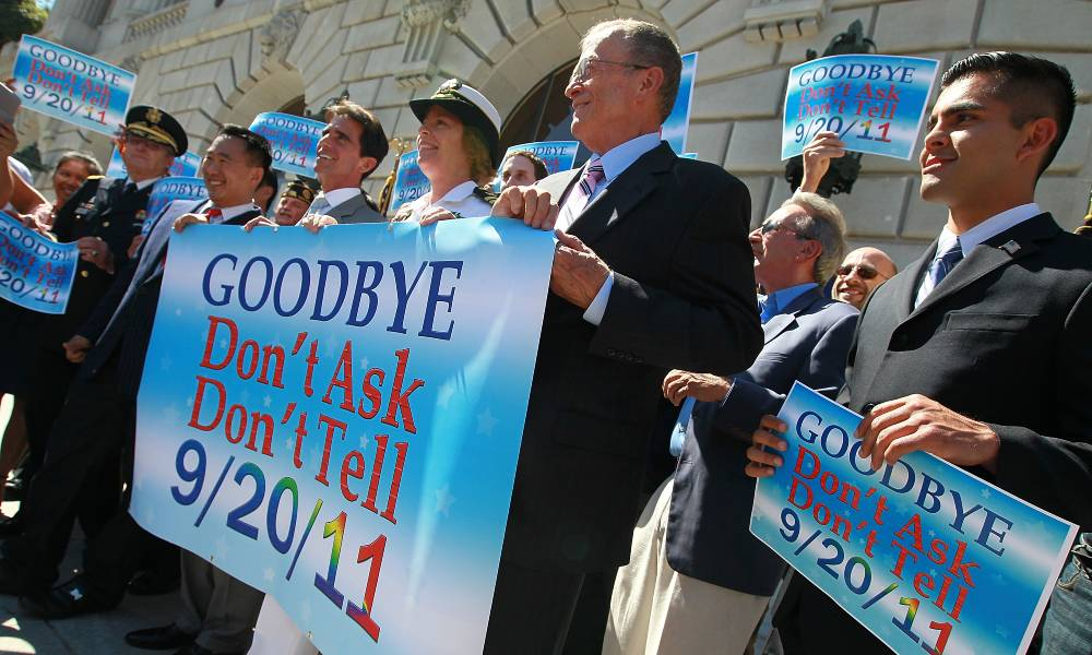 """Local leaders and former military members hold a banner during a conference marking the end of """"Don't Ask, Don't Tell"""" on 20 September 2011"""