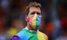 Sebastian Vettel wears a rainbow coloured shirt and face mask at the F1 Grand Prix of Hungary