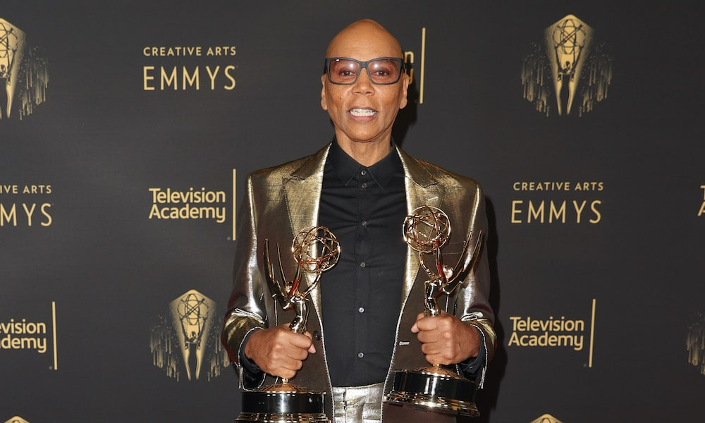 RuPaul on the red carpet at the creative arts Emmys holding his awards