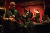 Pup EKO role-plays an obedient dog at a dungeon party.
