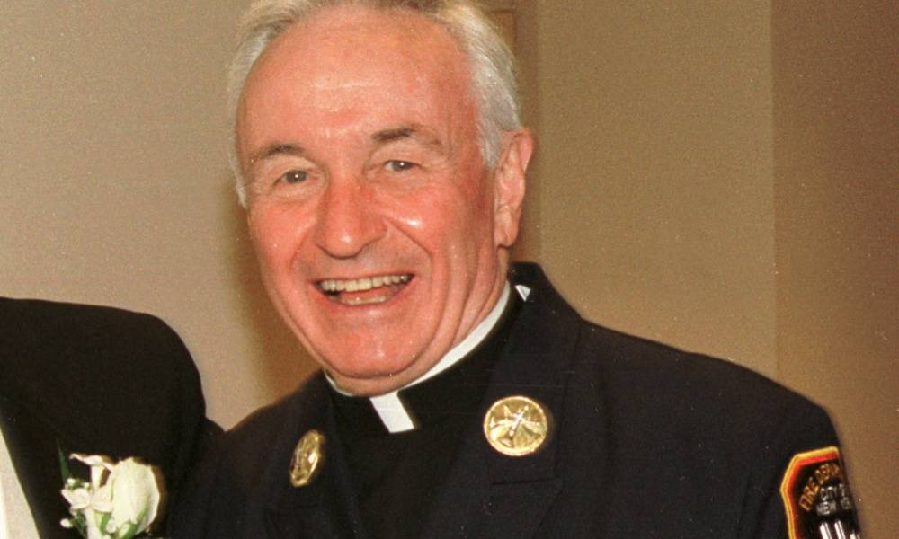Fire Department chaplain Mychal Judge smiles for a photograph 28 July 2001, Judge was killed in the 9/11 attack later that year