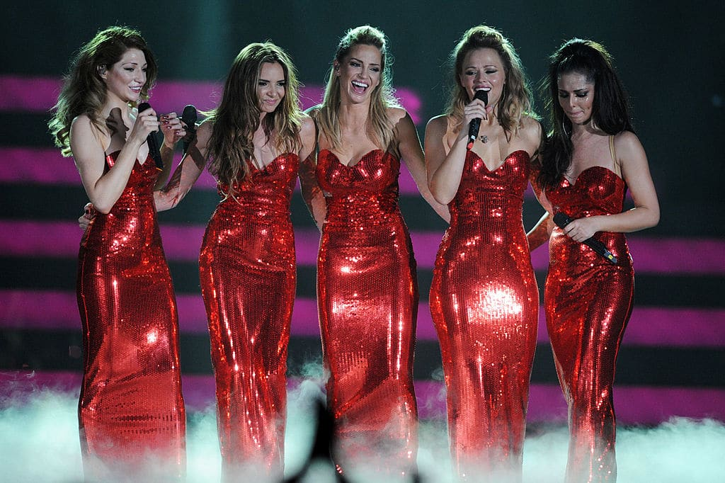 """Kimberley Walsh, Nicola Roberts, Nadine Coyle, Cheryl Cole and Sarah Harding of Girls Aloud perform on stage on the first night of their """"Girls Aloud - The Hits Tour 2013"""" tour."""