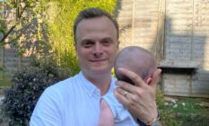 Just Like Us chief executive Dominic Arnall holding his child