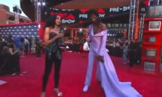 Lil Nas X in a lilac gown and MTV's red carpet host Jamila Mustafa