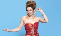 Veronica Green, a drag queen in a red dress with her hair piled on top of her head