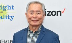 George Takei attends PFLAG conference in blue suit jacket and patterned shirt