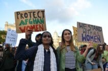 Protesters hold placards reading 'protect Afghan women'