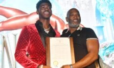 A picture of Lil Nas X and his father Robert Stafford holding up a plaque at a homecoming event for the rapper in Atlanta Georgia