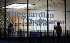 A picture of The Guardian and The Observer logos at the newspapers' London offices