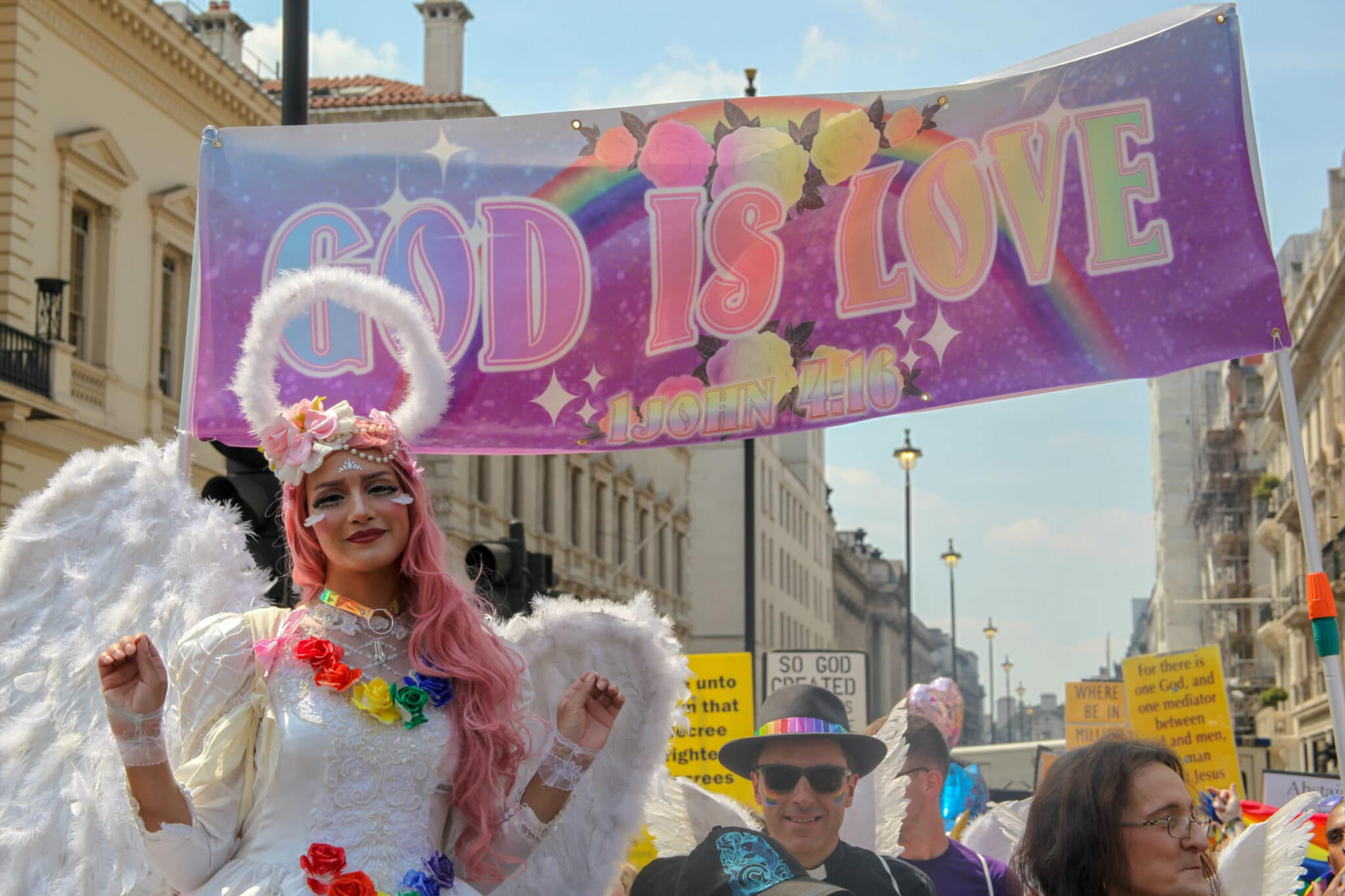 """LGBT+ Christians at Pride in London, 2018, with a banner that reads: """"God is love"""""""
