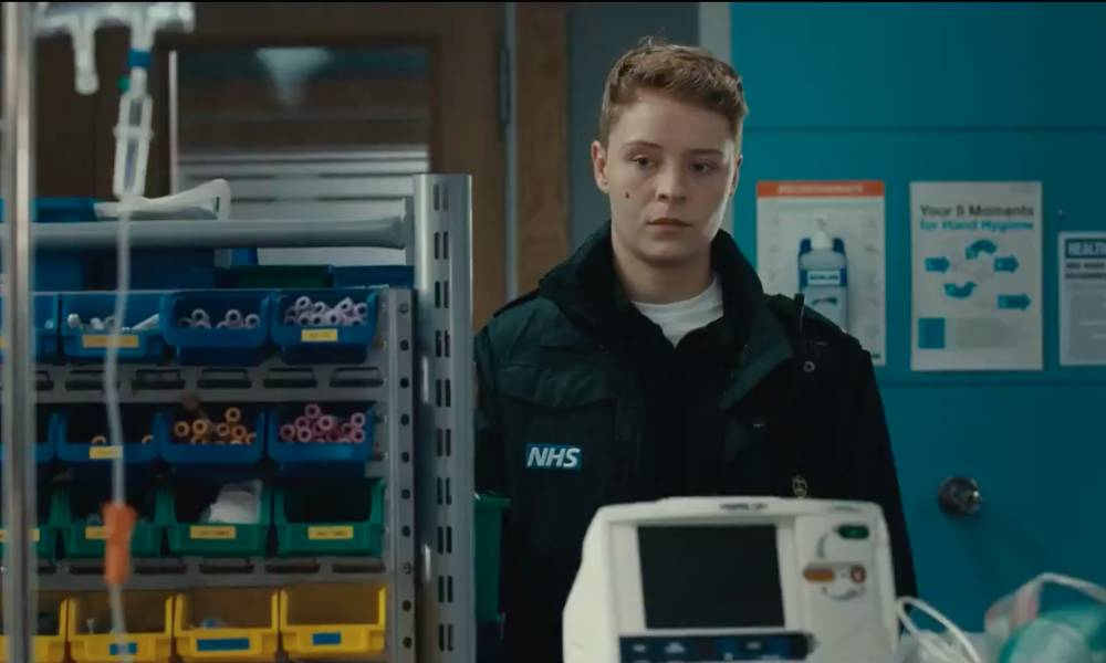 A still from Casualty showing Sah, a new recruit to the paramedic team. Sah is Casualty's first trans recurring character, and they are played by Arin Smethurst.